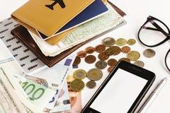 Телефон денег пасспорта с картой и стекла на белой предпосылке, Стоковая Фотография