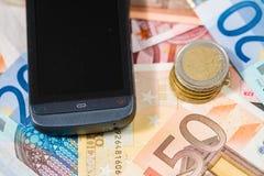 Телефон и деньги Стоковые Изображения