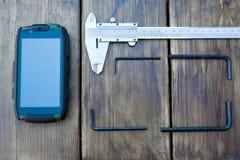 Телефон и крумциркуль Стоковая Фотография RF