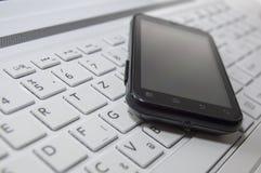 телефон компьтер-книжки клавиатуры Стоковое Изображение RF