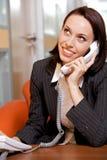 телефон назеиной линия коммерсантки беседуя Стоковое Изображение