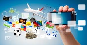 Телефон руки и мультимедиа стоковые фото