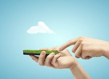 Телефон с травой Стоковая Фотография