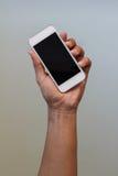 телефон удерживания руки франтовской Стоковые Фотографии RF