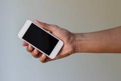телефон удерживания руки франтовской Стоковые Изображения RF
