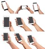 телефон удерживания руки франтовской Стоковая Фотография RF