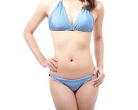 Тело женщины с голубым бикини Стоковое Фото