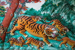 Тигры на стене Стоковые Фото