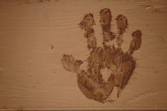 Тинное Handprint на древесине Стоковое Изображение