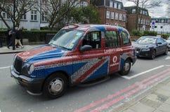 Покрашенное такси Лондона Стоковые Изображения