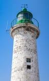 Типичный для Средиземного моря плавает вдоль побережья старый маяк Стоковое Изображение