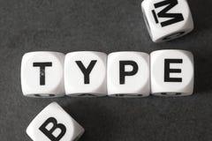 Тип слова на кубах игрушки Стоковая Фотография