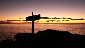 Тихий океан заход солнца с перекрестным силуэтом Стоковое Фото