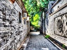 Тихий путь переулка Hutong в городском Пекине Стоковое Изображение