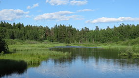 Тихое озеро в южной Финляндии Стоковые Изображения