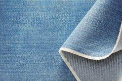 Ткань джинсовой ткани голубых джинсов Стоковое Фото