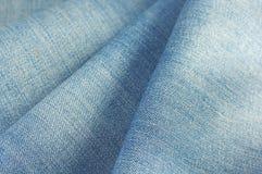 Ткань джинсовой ткани голубых джинсов Стоковые Изображения