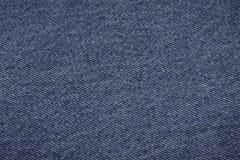 ткань джинсовой ткани предпосылки голубая стоковое фото rf