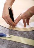 Ткань портноя зазубрины рук Стоковая Фотография