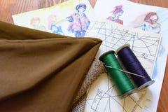 Ткань, потоки, игла, чертежи, схемы, картины иллюстрация штока