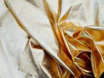 Ткань сатинировки золота Стоковые Фото
