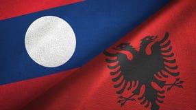 Ткань ткани флагов Лаоса и Албании 2, текстура ткани иллюстрация штока