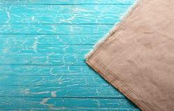Ткань холста на голубой предпосылке Стоковое фото RF