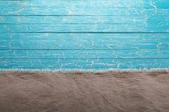 Ткань холста на голубой предпосылке Стоковые Изображения RF