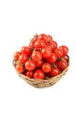 Томаты вишни в корзине изолированной на белизне Стоковое фото RF