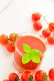 Томаты вишни здорового сока еды красные Стоковая Фотография