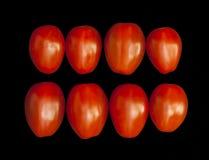 Томаты вишни на черной предпосылке Стоковые Изображения RF