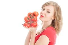 томаты девушки Стоковая Фотография
