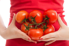 томаты девушки Стоковые Изображения