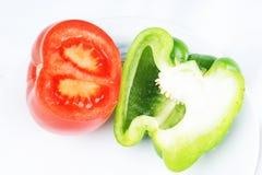 томаты зеленых перцев Стоковые Фото