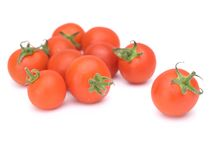 томаты изолированные вишней белые Стоковое фото RF