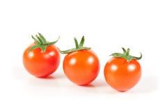 томаты изолированные вишней органические белые Стоковое Изображение RF