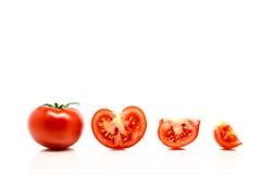 томаты изолированные предпосылкой красные белые стоковые фото