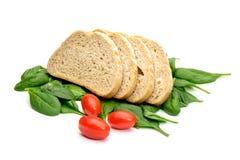 Томаты и шпинат хлеба Стоковые Изображения RF