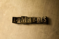 ТОМАТЫ - конец-вверх grungy слова typeset годом сбора винограда на фоне металла Стоковые Изображения