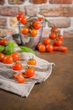 томаты красного цвета вишни малые стоковое фото rf