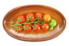 томаты красного цвета плиты стоковая фотография rf