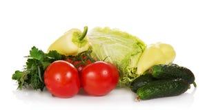 Томаты, огурцы, перец, зеленые цвета и Стоковое Изображение
