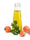 томаты петрушки масла листьев бутылки прованские Стоковые Изображения RF
