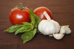 томаты чеснока базилика Стоковое Изображение RF