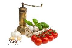 томаты чеснока базилика Стоковая Фотография