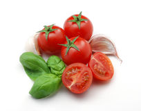 томаты чеснока базилика Стоковое фото RF