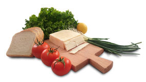 томат, лимон, салат, хлеб, свежий лук салата и сыр Стоковые Фото