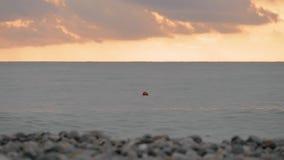 Томбуй на море suset - Georgia акции видеоматериалы