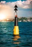 Томбуй с красным светом в море Стоковая Фотография