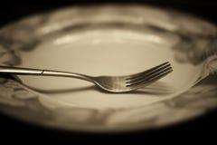 Тонизированная вилка в monochrome плиты Стоковое Фото
